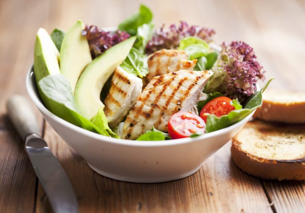 salad with avocado and grilled chicken fillet
